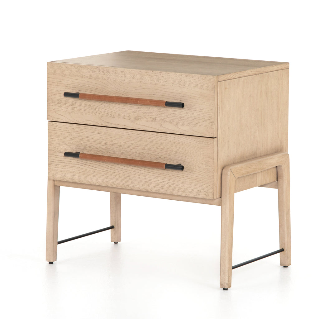 "The light-finished oak of this Rosedale Nightstand brings a clean, brightness to any room. We love how the two spacious drawers have iron hardware wrapped in a gorgeous, tan leather. The dimension legs with iron connecting them bring a unique look to your bedroom or other area! Overall Dimensions: 27.25""w x 19.50""d x 26.00""h Materials: Oak Veneer, Top Grain Leather, Iron, Solid Oak"