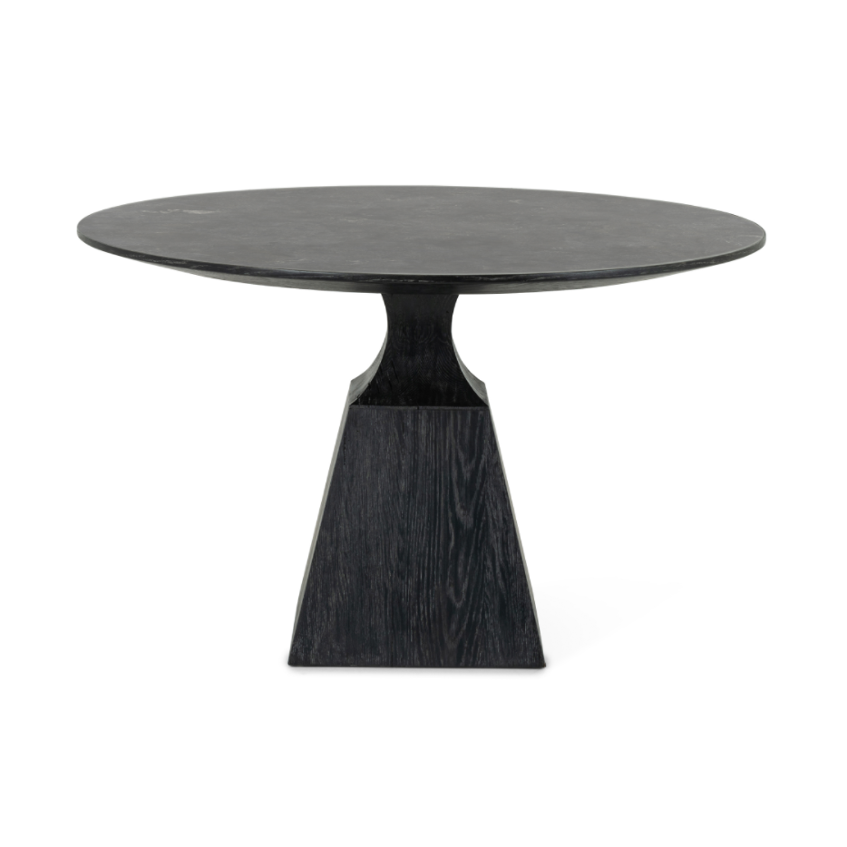 "We love the unique bell shape of this Sargon Bluestone Dining Table. It brings an industrial feel to any dining room.   Size: 53.25""w x 53.25""d x 30""h  Colors: Washed Black, Bluestone Materials: Solid Oak, Bluestone"