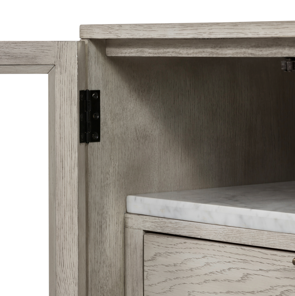 "With glass windows opening to shelves and a single drawer, this Viggo Cabinet Nightstand - Vintage White Oak is both functional and beautiful. The oak veneer is finished with a dry hand for a light, farmhouse look.   Overall Dimensions: 28.00""w x 18.00""d x 29.00""h Colors: Vintage White Oak, Bronze Antimony, Vintage White Oak Solid, Italian White Marble Materials: Oak Veneer, Iron, Solid Oak, Solid Marble"