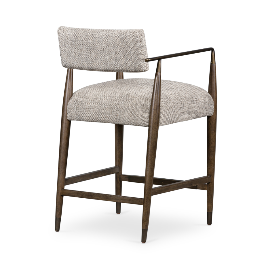 Slim, sculptural style with this Waldon Bar + Counter Stool. Angular framing features a mix of bronze-finished metal and solid rubberwood, for a forward-thinking feel. Textural linen-blend seating adopts an invitingly neutral grey hue to move freely between spaces and styles.