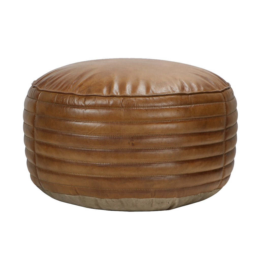 Come home to stylish comfort. This gorgeous round ottoman can be used for lounging or as additional seating. Pairs best with the Tackshop Lounge Chair.