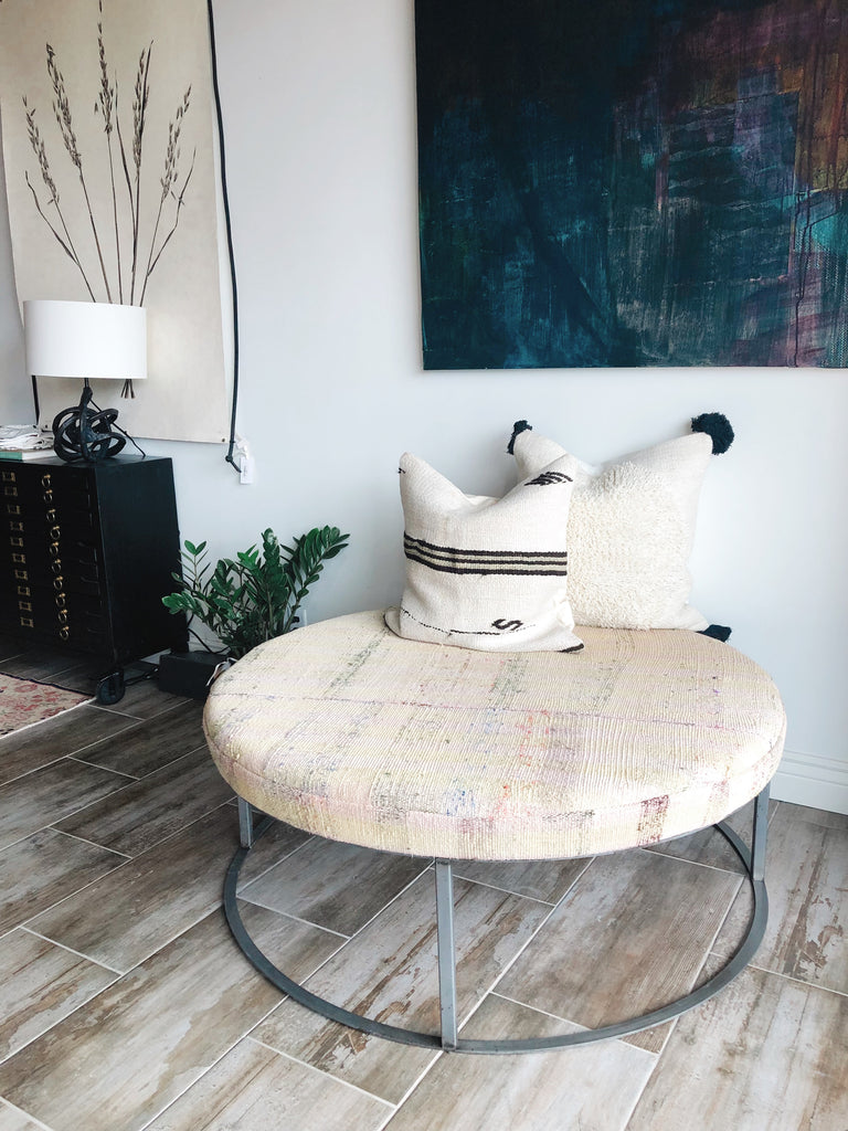 Featuring a custom vintage textile wrapped oversized coffee table available at Amethyst Home.