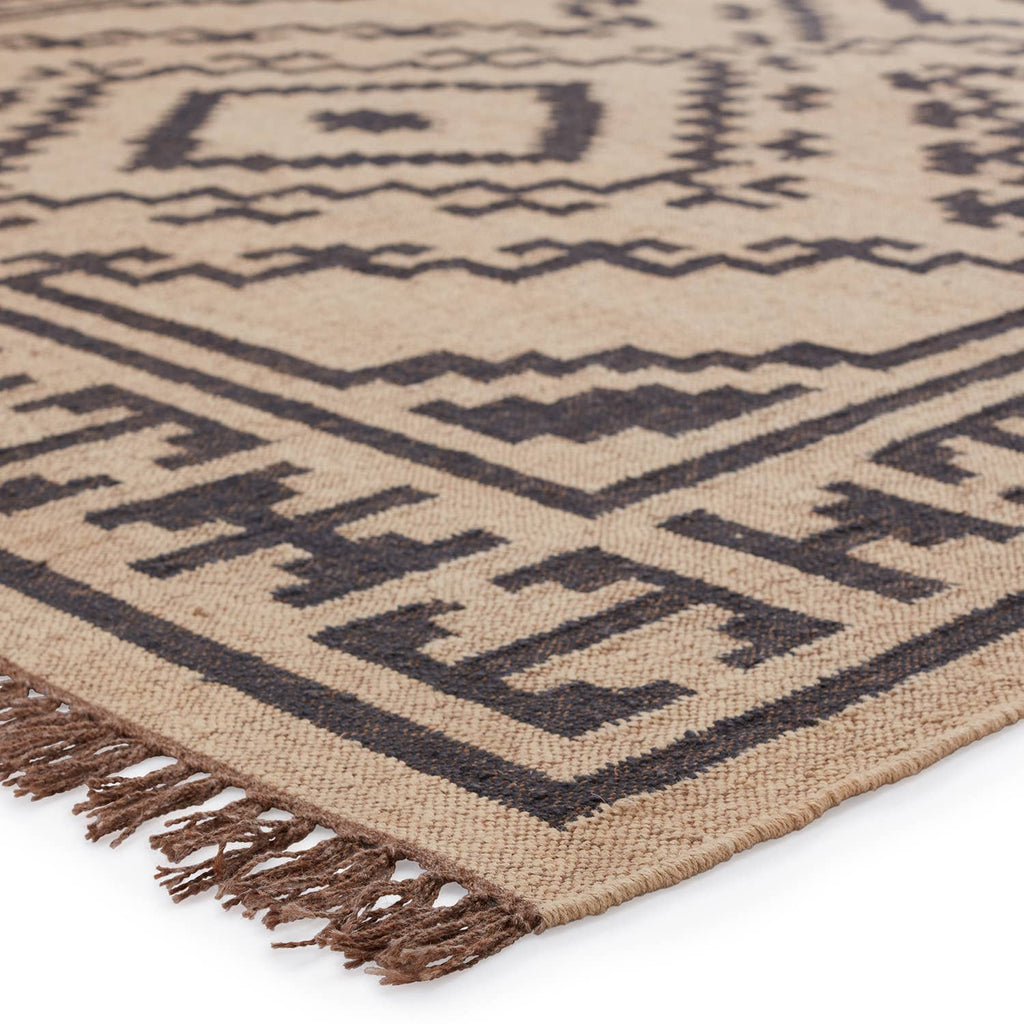 This Jaipur Living Bedouin Jaima Area Rug, or BD24, is a handwoven area rug offering a fresh take on a bold and open tribal medallion in easy-to-decorate colors of light beige and deep black. Crafted of durable and texture-rich jute, this natural, flatweave area rug grounds spaces and adds a worldly vibe to any room.