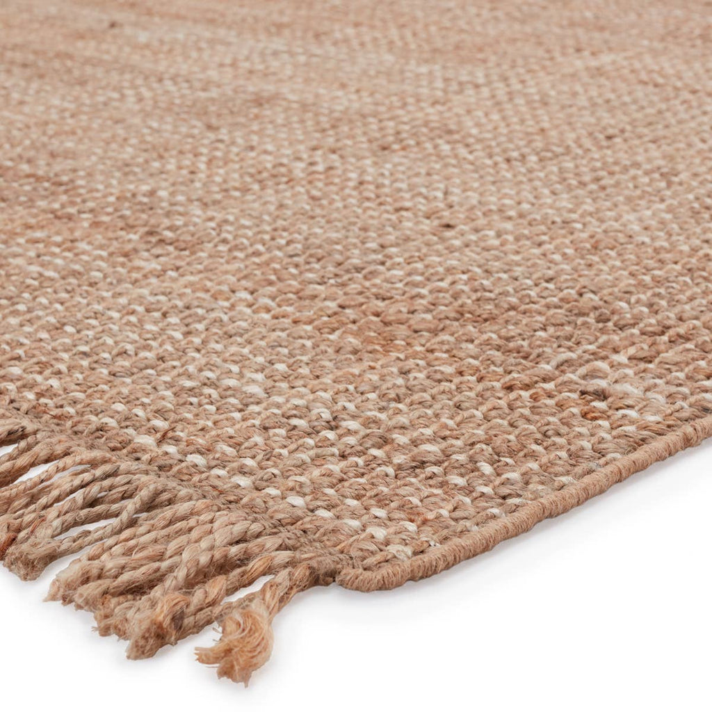 This Jaipur Living Naturals Lucia Sauza Area Rug, or NAL08, is a natural jute area rug offering a chunky weave foundation to transitional spaces. This casually elegant layer lends an earthy accent in a duo-toned ivory and beige colorway. The knotted fringe lends global charm to this handwoven design.
