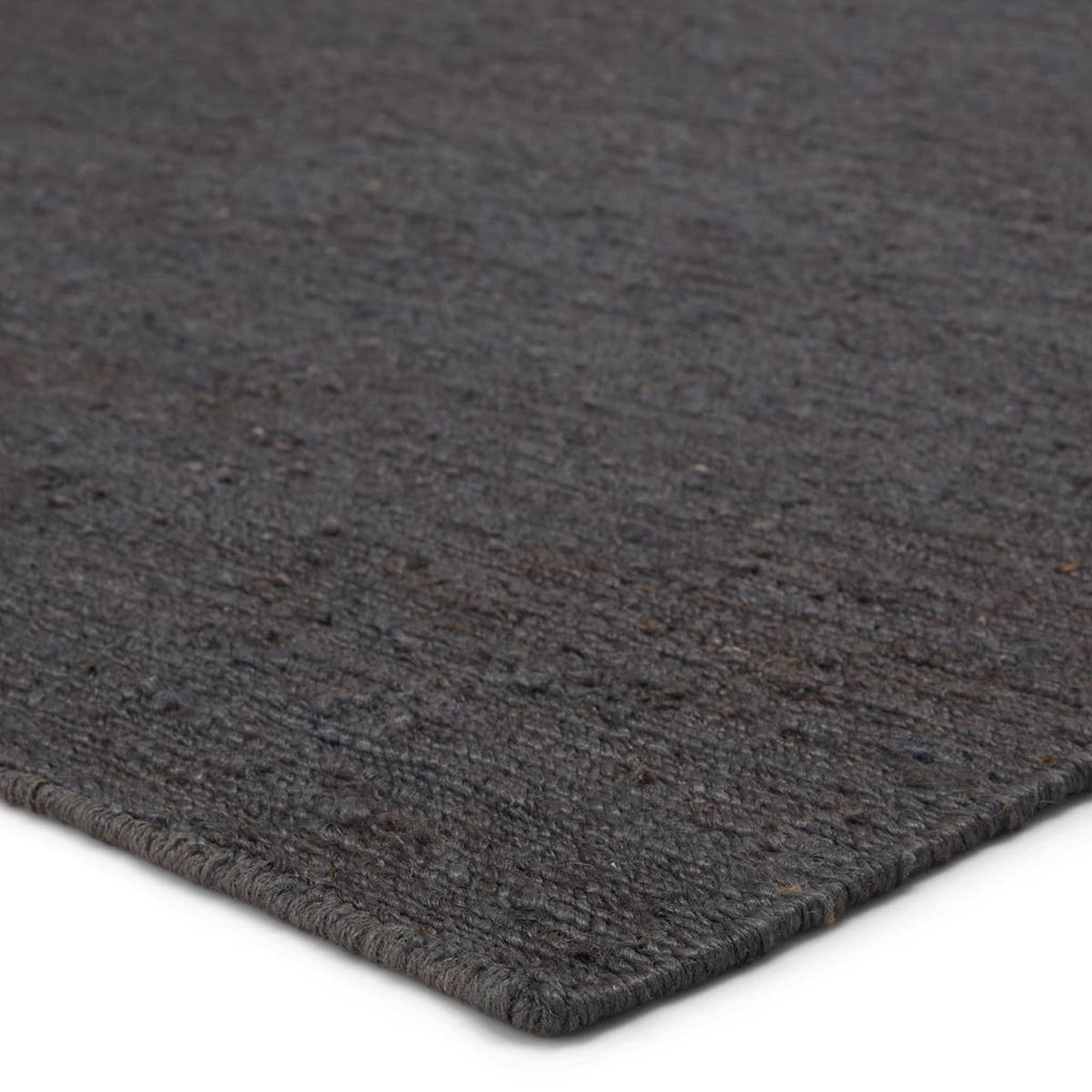 The Sabine collection lends rich texture and organic allure to modern homes. The Linden rug features a fine, single-line Sumak knotting technique for an exquisite feel and craftsmanship. This rich, black natural rug is the perfect accent for sophisticated spaces in want of a grounding layer. Natural  80% Jute I 20% Cotton SAB02