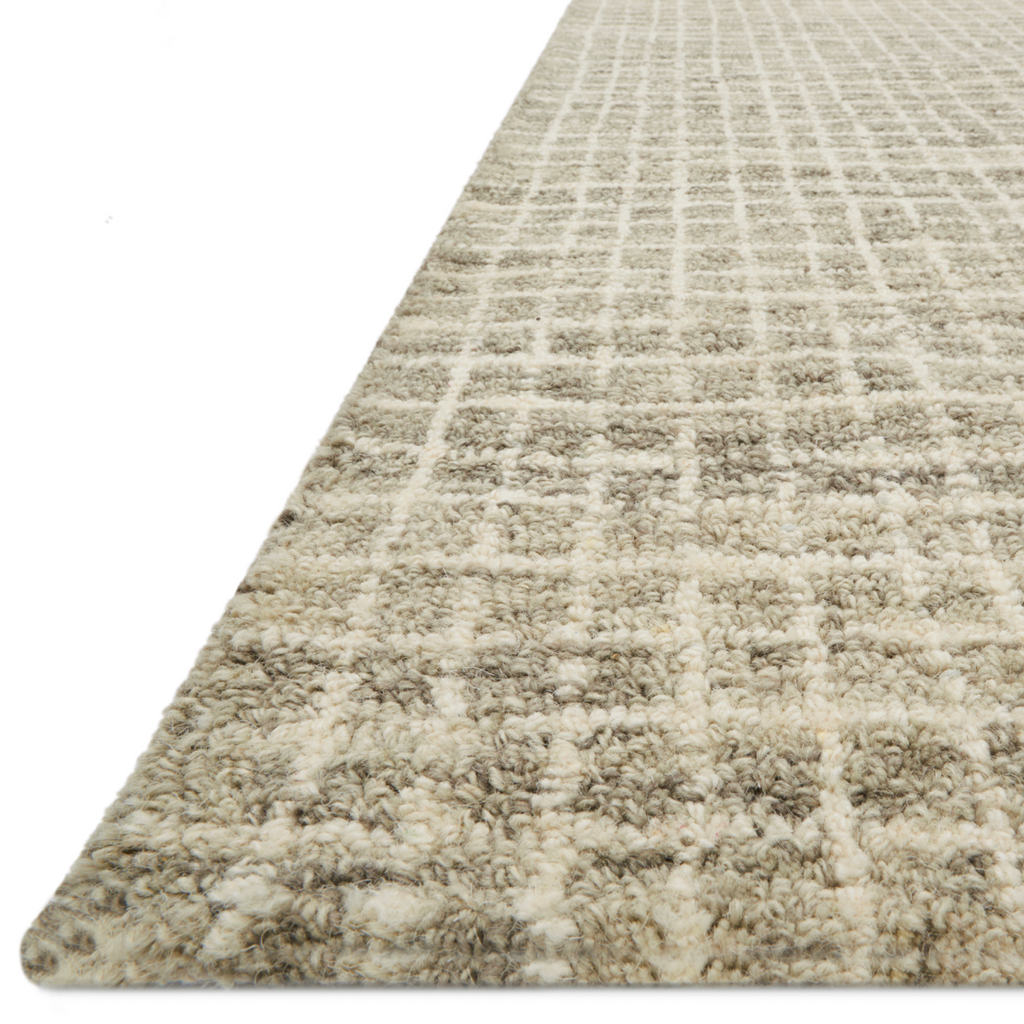 Inspired by textural watercolors, the Giana Granite Area Rug combines a relaxed grid with soft variations of cream and beige for an effortless and sophisticated look. Each area rug is hooked of 100% wool by artisans for a beautiful textural layer to your home. The soft textures of this area rug bring warmth and coziness to any room.  Hooked 100% Wool GH-01 Granite