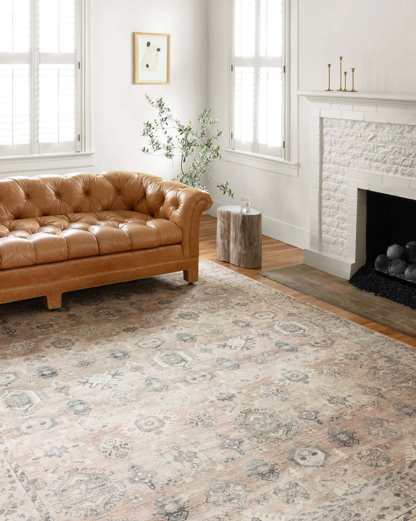 Featuring soft motifs in a carefully curated color palate of ivory, red, grey, and hints of blue, the Hathaway Java / Multi area rug captures the essence of one-of-a-kind vintage or antique area rug at an attractive price.