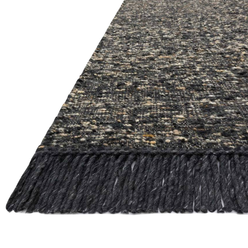 The Irvine rug lays a cozy foundation in a bedroom, living room, or family room for the perfect casual retreat. The rug has gorgeous tones of black, ivory, and pops of yellow for a cozy look. Crafted by Loloi for ED Ellen DeGeneres.  Hand Woven 81% Wool | 10% Cotton | 9% Polyester IRV-01 ED Charcoal Colors: Black, Taupe, Yellow