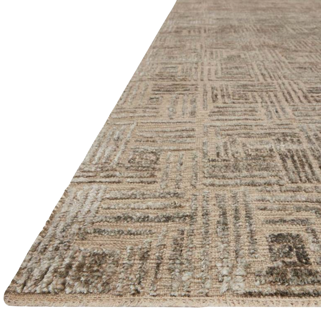 Featuring tone on tone geometric patterns, the Lana Stone Area Rug is hand-knotted of wool, viscose and cotton. Crafted in India, the refined high-low pile is a testament to the dedication of craftsmanship required to create each area rug. This would go great in a living room, kitchen, or other medium to high-traffic areas.   Hand Knotted 41% Wool | 39% Viscose | 18% Cotton | 2% Other Fiber Pile LNA- 01 Stone