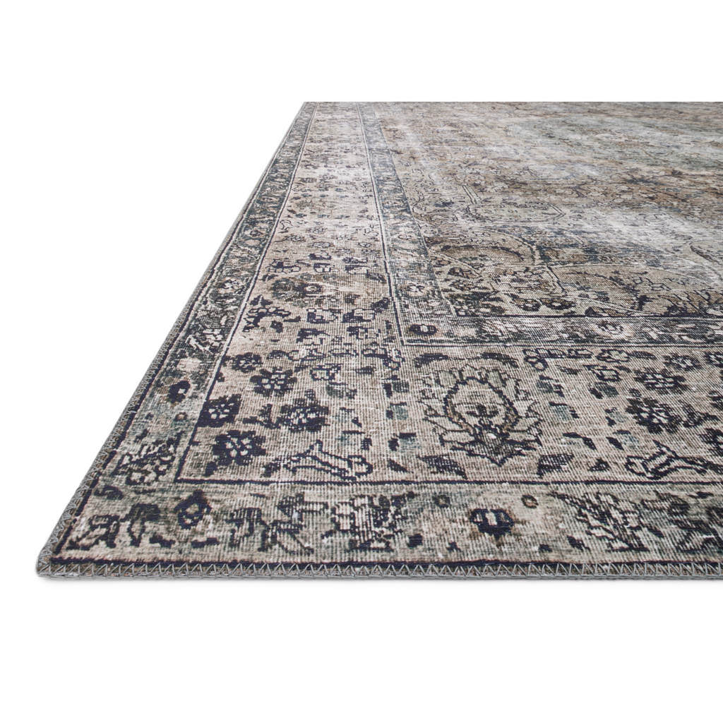The Layla Collection is traditional and timeless, with a beautiful lived-in design that captures the spirit of an old-world rug. This traditional power-loomed rug is crafted of 100% polyester with a classic and sophisticated color palette and subtle patina.  Power Loomed 100% Polyester LAY-06 Taupe/Stone