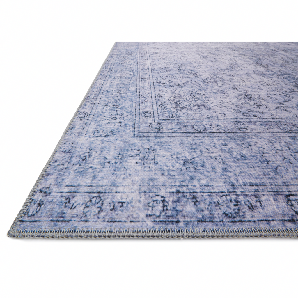 Timeless and classic, the Loloi Loren Slate Area Rug, or LQ-09, offers vintage hand-knotted looks at an affordable price. Created in Turkey using the most advanced rug-making technology, these printed designs provide a textured effect by portraying every single individual knot on a soft polyester base.