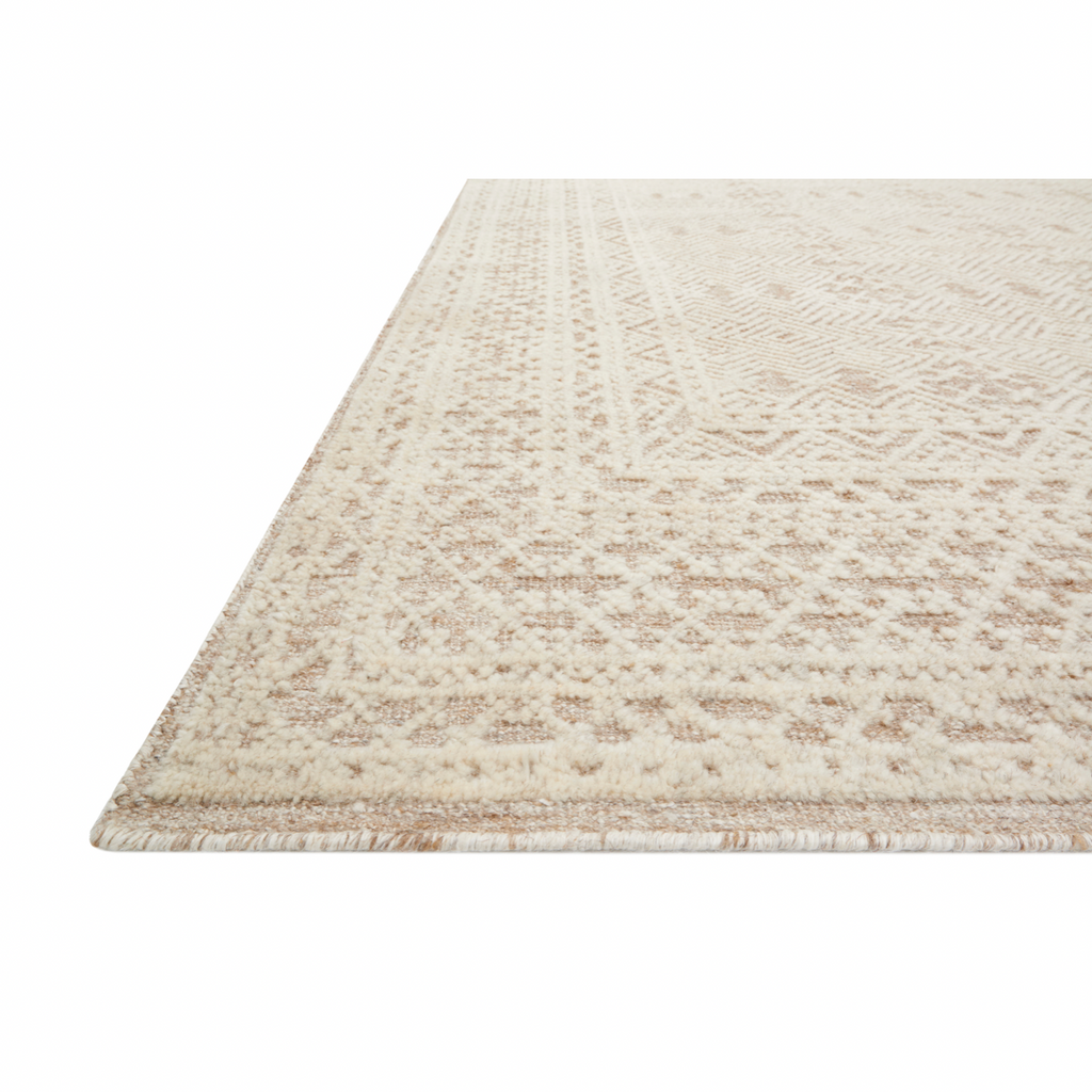 The Origin Oatmeal / Ivory area rug from Loloi is hand-knotted by skilled artisans and offers a richly textured surface with pronounced visual depth. You will love this rug because the rug is:  Cozy and soft texture Very easy to clean and maintain Comes in big area rug sizes and as cute smaller sizes Perfect for a living room, bedroom, or dining room Gorgeous intricate pattern and patina to warm up any room
