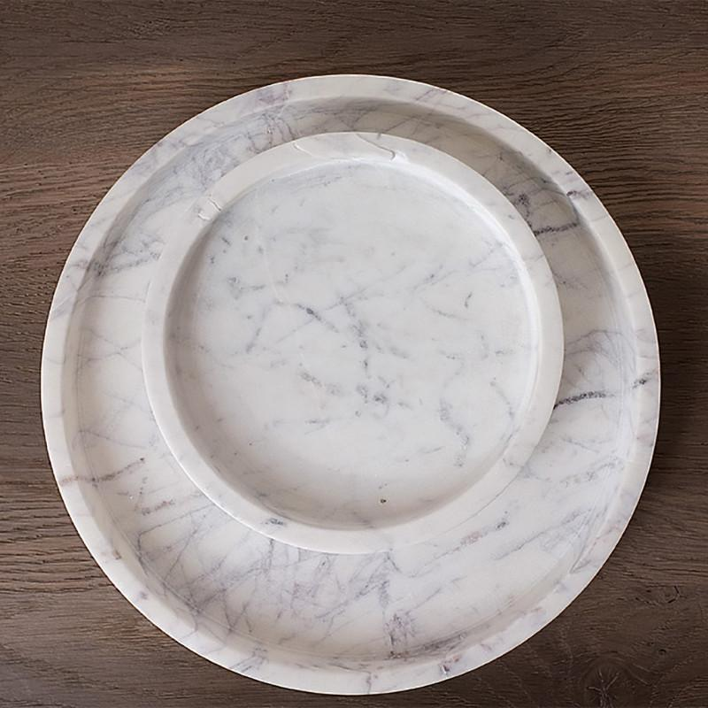 This large marble round tray is the ultimate accessory for entertaining. Perfect for larger events, the white marble is ideal for displaying delicious cheeses, tasty proteins, and delectable bread for serving. The tray is crafted from natural white marble stone with subtle hues of purple and grey swirling veins.
