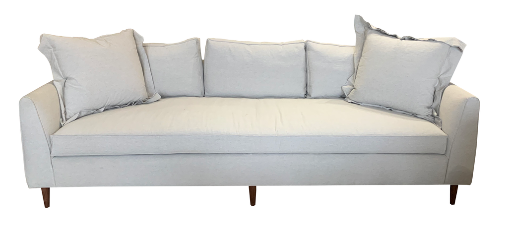The lovely Nina Sofa is a Verellen best seller! Bench-crafted in North Carolina, it features spring down seat construction, loose bench seat cushion, slipcover style (finishing stitch in place of hemline on slipcover), and standard upholstered legs.