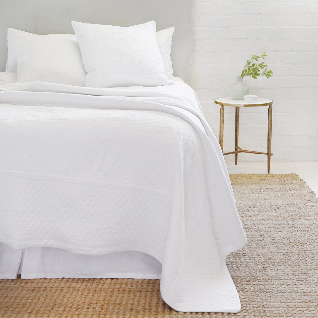The Marseille Coverlet Bedding White by Pom Pom is luxurious and elegant with a detailed floral and diamond quilted pattern on the front made of 100% stone washed cotton velvet.   100% cotton velvet Machine wash cold; tumble dry low; warm iron as needed Do not bleach
