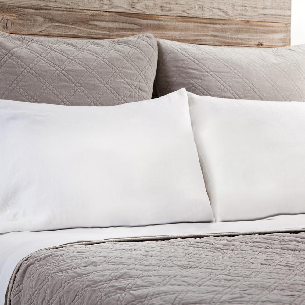 The Brussels Coverlet Bedding Taupe by Pom Pom at Home is a grand and sophisticated line that has a diamond quilted pattern on the front, made of 100% stone washed cotton velvet. Available in several soft, stone washed colors.  100% cotton velvet Machine wash cold; tumble dry low; warm iron as needed Do not bleach