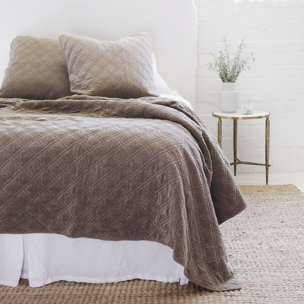 The Brussels Coverlet Bedding Walnut by Pom Pom at Home is a grand and sophisticated line that has a diamond quilted pattern on the front, made of 100% stone washed cotton velvet. Available in several soft, stone washed colors.  100% cotton velvet Machine wash cold; tumble dry low; warm iron as needed Do not bleach