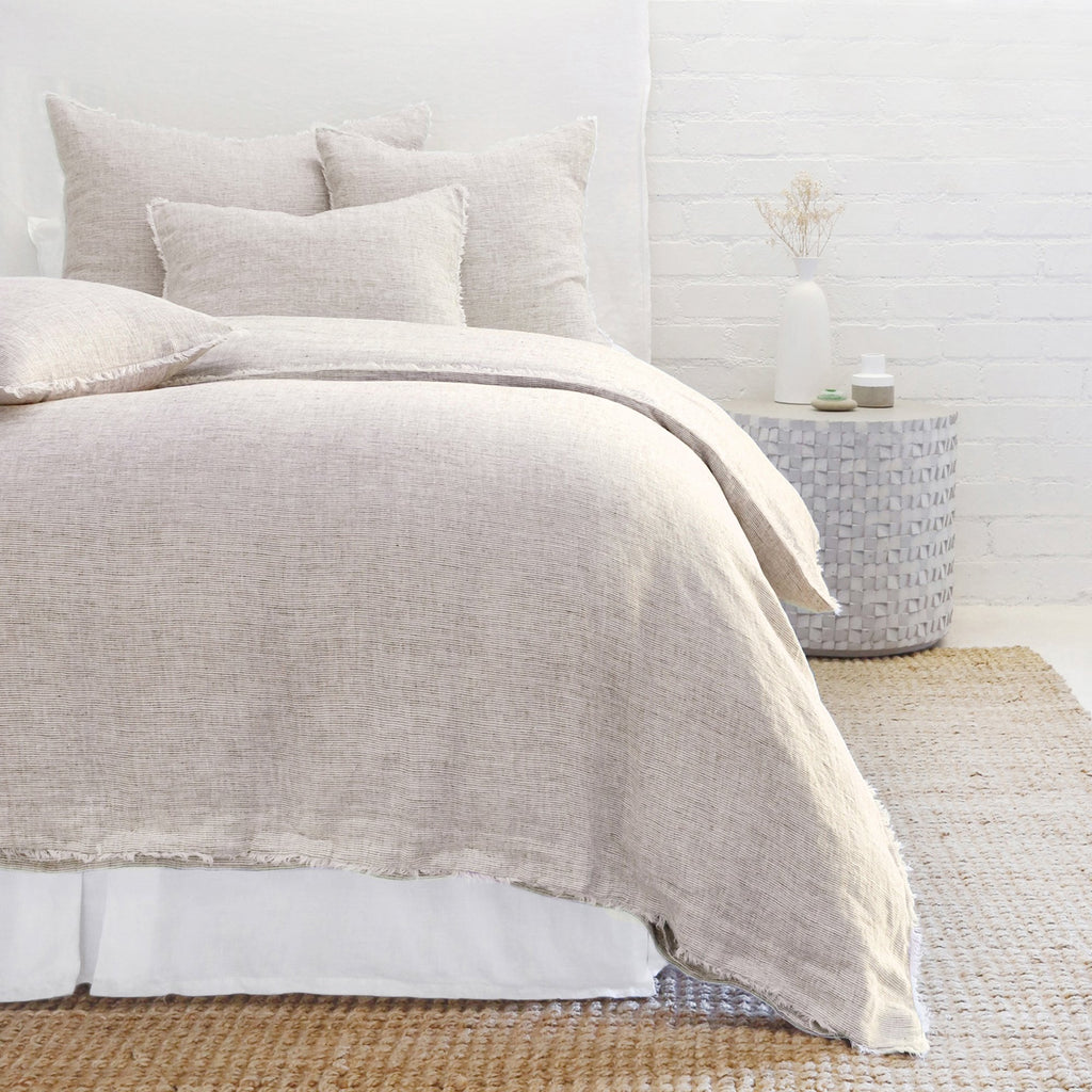 Subtle frayed edges of soft linen add a dash of unexpected detail to this Logan Duvet Collection Terra Cotta by Pom Pom at Home. Woven with two different colored yarns for a heathered effect, the duvet cover and shams feature shell button closures.  Inserts sold separately 100% linen Shell-button closure Machine wash cold; tumble dry low; warm iron as needed. Do not bleach