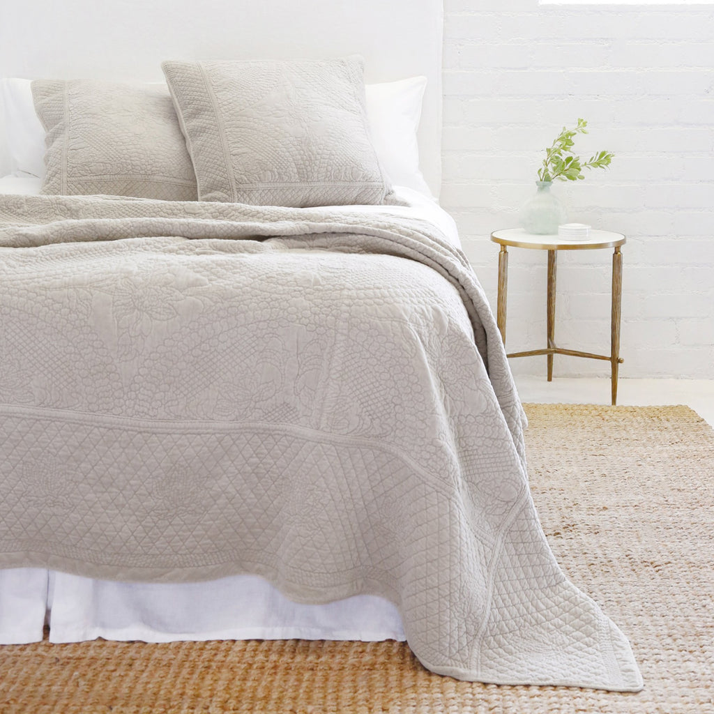 The Marseille Coverlet Bedding Taupe by Pom Pom at Home is luxurious and elegant with a detailed floral and diamond quilted pattern on the front made of 100% stone washed cotton velvet.  100% cotton velvet Machine wash cold; tumble dry low; warm iron as needed Do not bleach