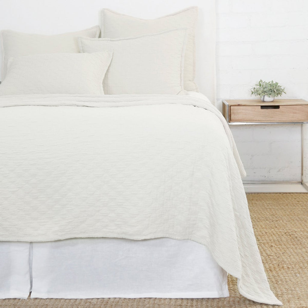 Crafted in Portugal, the Ojai Greige Matelasse Collection by Pom Pom at Home is light and casual, bringing comfort with its subtle diamond pattern. The coziest bedding to climb into after a long day.   100% cotton. Machine wash cold; tumble dry low; warm iron as needed. Do not bleach