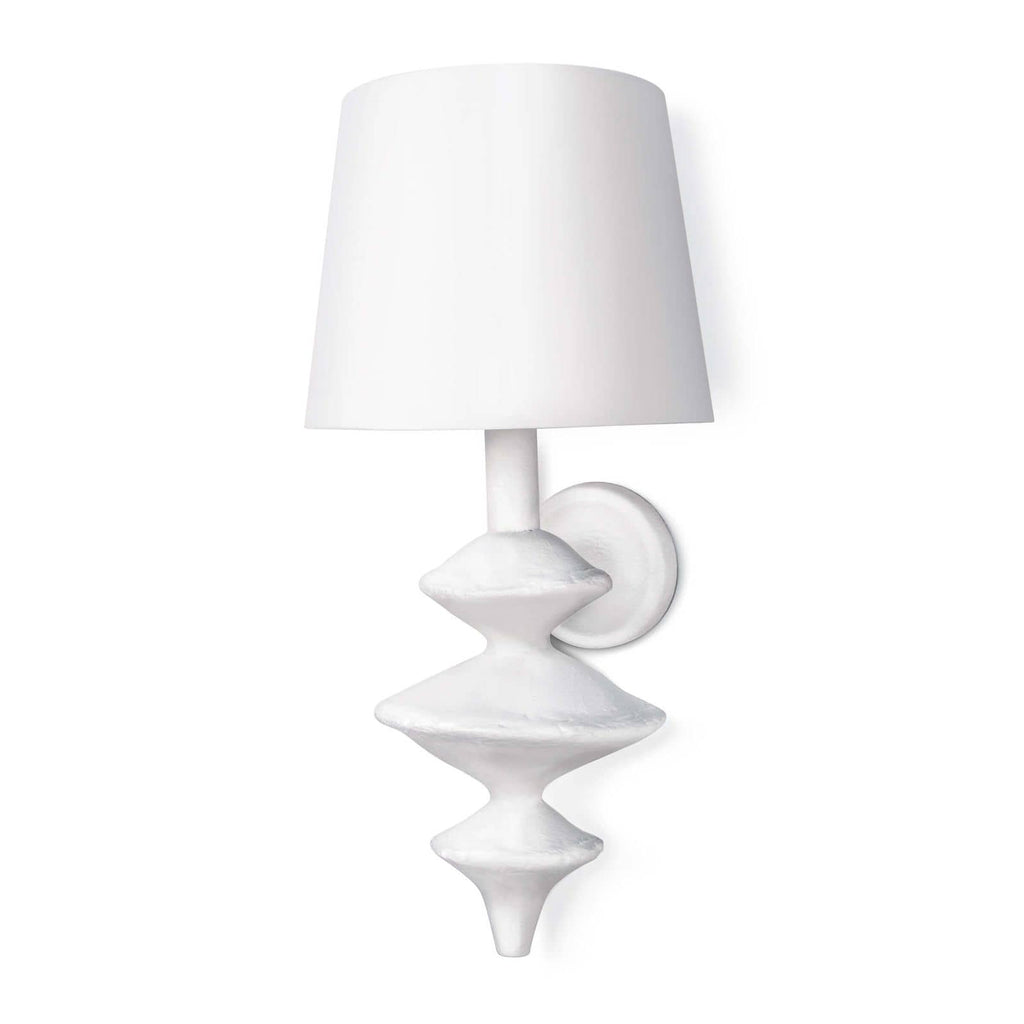 "The curves on this Hope Sconce with the matte white finish give this sconce a textured look. This is inspired by a paper mache sculpture and would look amazing lined down a hallway, in your living room, or other space in your home needing extra light.  Overall size: 10""w x 10""d x 21""h"
