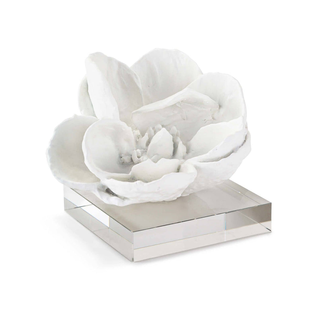 "This Magnolia Objet is a magnolia flower beautifully captured in a white finish and set atop an acrylic base. Both modern and elegant, this will be your new favorite accessory in your living room, office, or other area of your home!  Overall size: 6""w x 6""d x 5""h Material: Resin Finish: White"