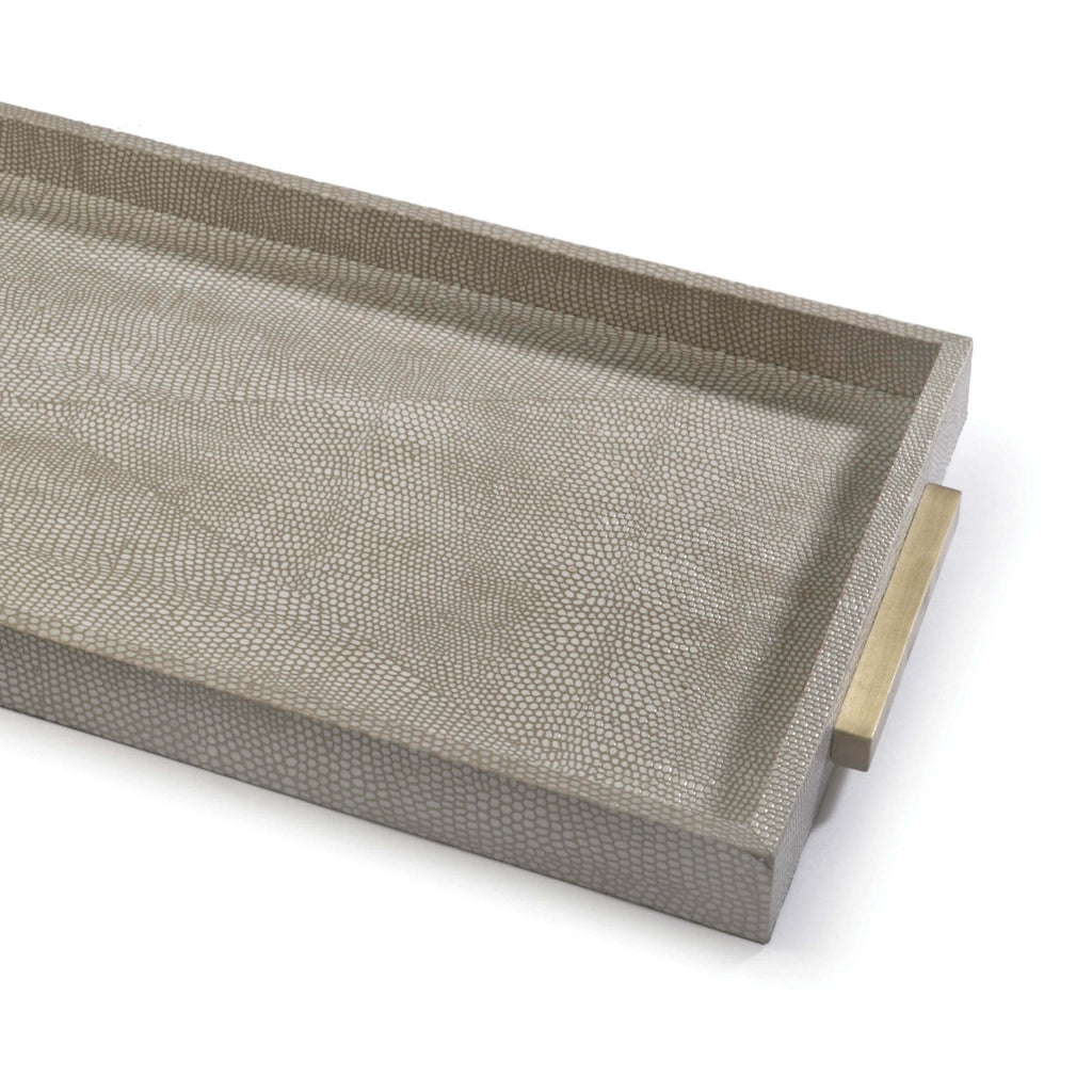 "This Rectangle Shagreen Boutique Tray is wrapped in a textured, ivory grey faux shagreen. Whether it's on your ottoman or entryway console, this is the perfect tray to place your favorite candle + magazine combo in.   Overall size: 12""w x 25""d x 1""h Material: MDF Finish: Ivory"