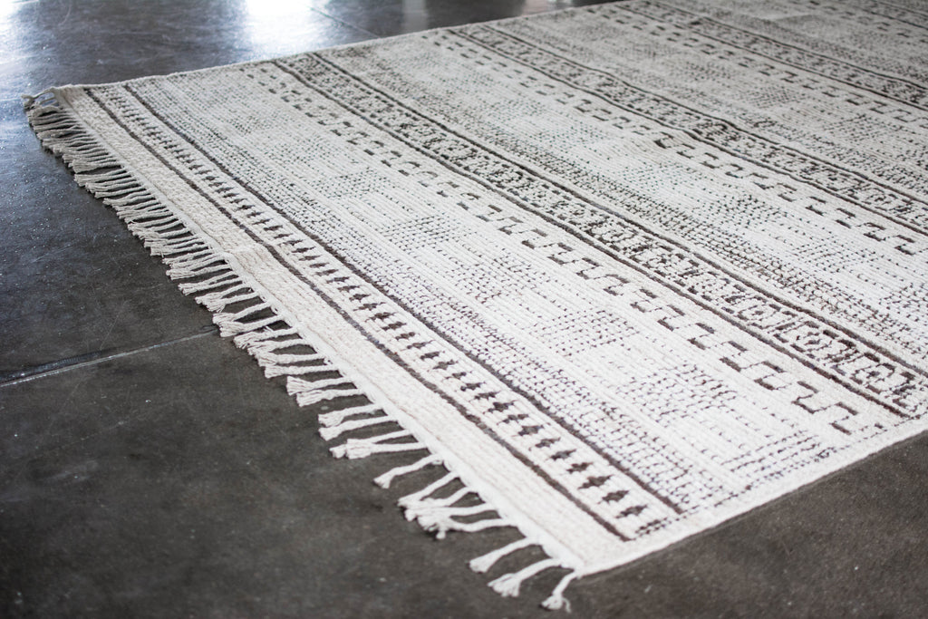 Intricately patterned brown & cream vintage Moroccan rug. Hand-knotted construction with a low pile for minimal shedding and a gorgeous understated look.  We love the intricacies of this pattern!  One-of-a-kind  100% Wool