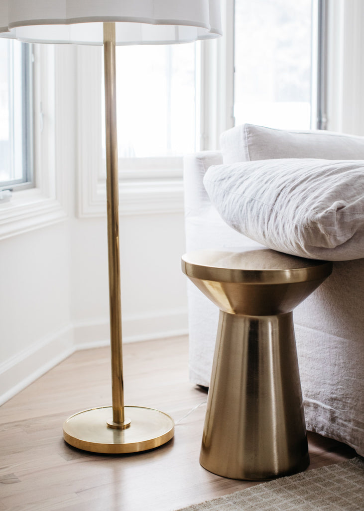 We love the silk shade and dimmer feature of the Simple Soft Brass Floor Lamp by Visual Comfort. It adds an elegant, warm glow to any living room, bedroom, or other area needing extra light.   Designer: Barbara Barry
