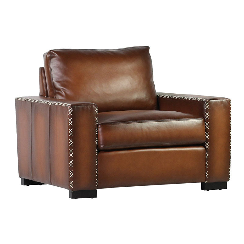 The XX Lounge Chair is a classic French club chair embellished with a unique X-stitching in a contrasting leather for added character and dimension. The channeled sides and back add depth and charm. We loved relaxing in this chair at market and know you would as well.