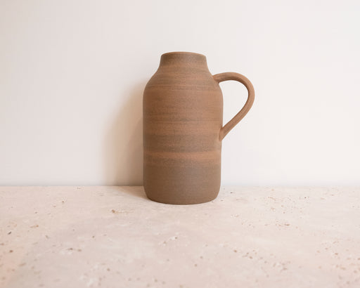 BROWN STONEWARE BOTTLE