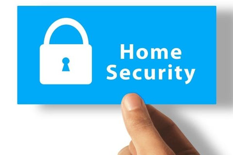 hand holding a home security sign