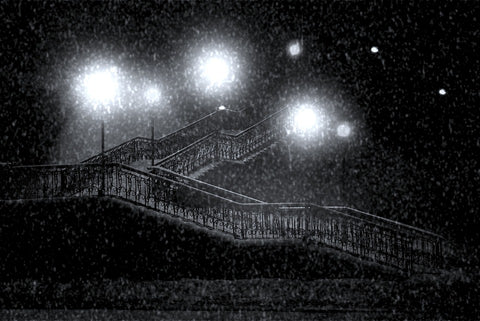 black and white stairs with large lights and snow