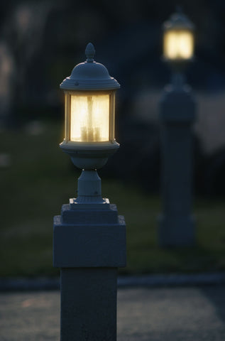 close up image of a lamp post with another lamp posts in the background