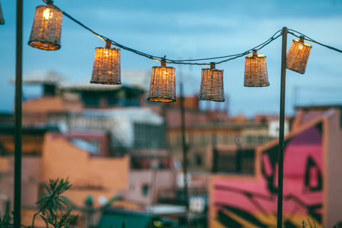 wooden lanterns hanging in a rope