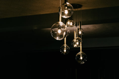 lit up glass pendant lamp on the ceiling