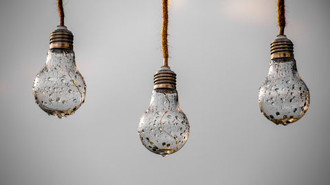 3 light bulbs soaked in water
