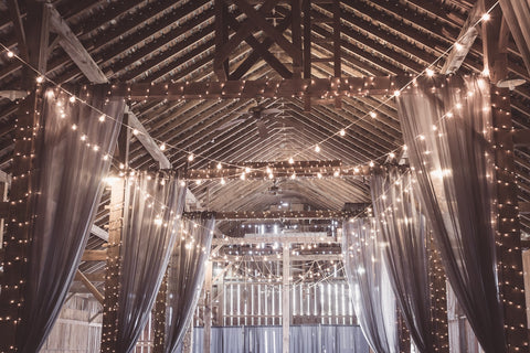 hall covered with string lights and light-colored drapes hanging