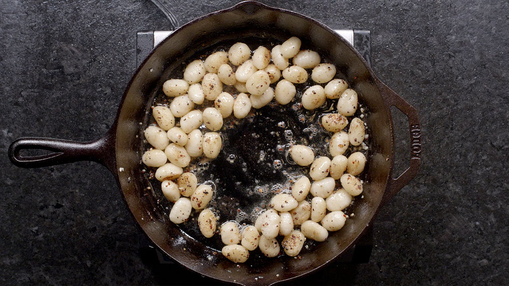 Lightly toast the cooked gnocchi pasta