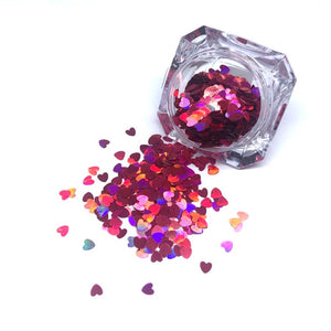 glitter hearts spilling out of jar in holographic pink