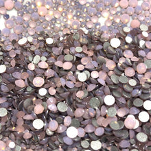 super close up of sparkly pink opal nail crystals