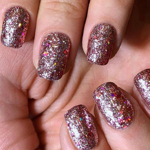 Nails done with diamond blush nail glitter, chunky holographic