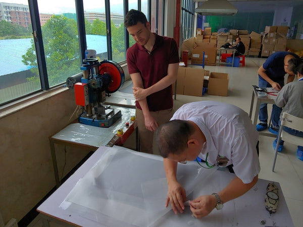 Alex at the screen supplier factory, spot-checking the quality inspection process.