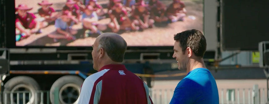 Wally Lewis and Brad Fittler in front of a screen