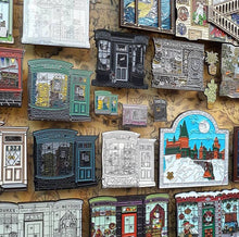 corkies are cork magnets seen displaying enamel pins on a magnetic board covered in a wizarding map