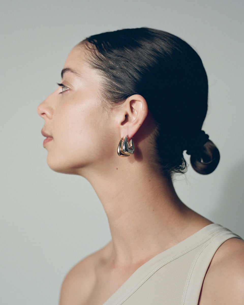 Model wearing J. Hannah Tetra Hoops II earrings in silver and 14k gold