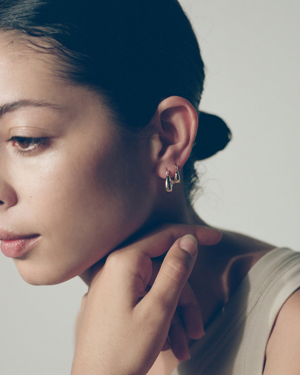 Model wearing double J. Hannah Tetra Hoops I