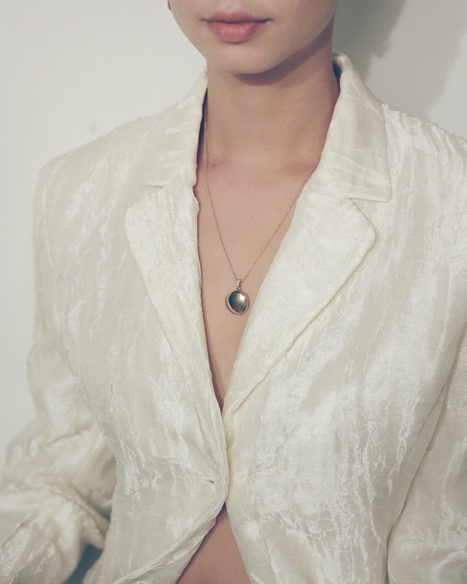 Model wearing J. Hannah Signature Locket necklace