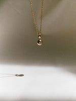 J. Hannah Diamond Form Pendant necklace in 14k gold in sun.