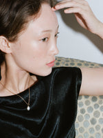 Model wearing J. Hannah Oval Mabe' Pearl Pendant